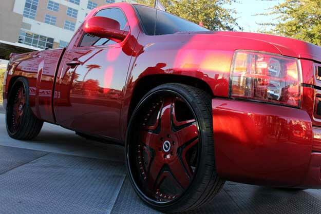 Red Chevy Silverado on 28's TIS TMO15 custom build wheels